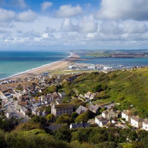 view overlooking Dorset beach town and coastline