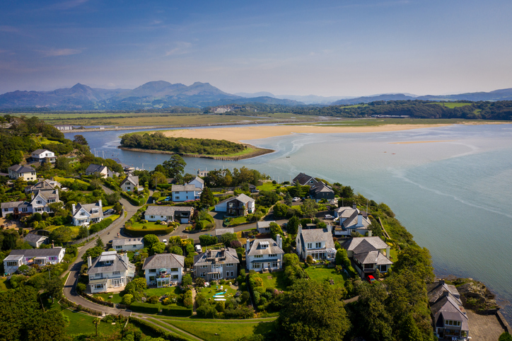 Ariel view of houses beach and bay share property