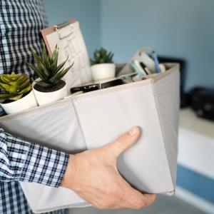 person collects box of belongings following lack of appeal in redundancy