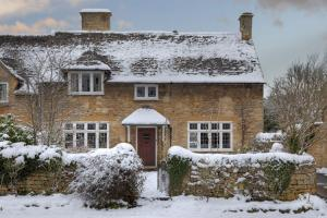 winter let holiday cottage in the snow