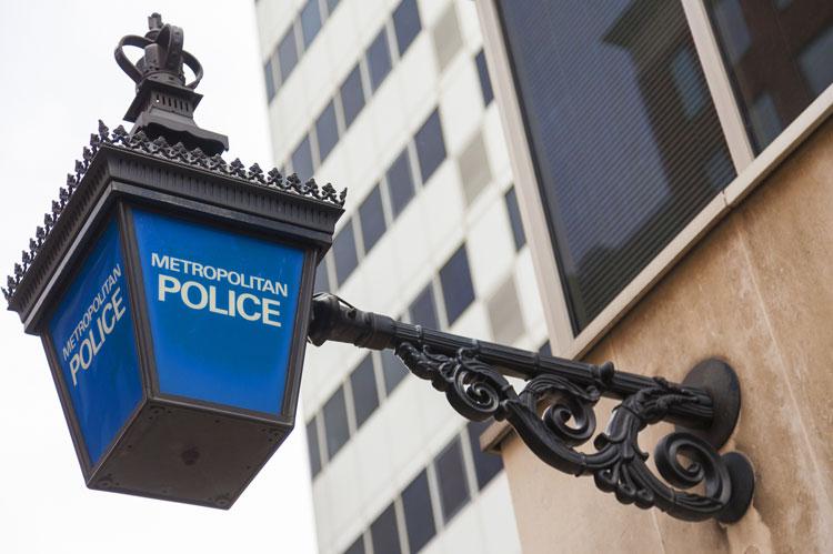 Metropolitan Police lamp sign outside police station